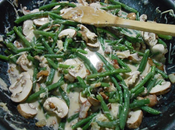 Now add beans, mushrooms and 1 c of Parmesan to sauce.  Stir really...