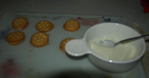 Remove dish from microwave and place next to the prepared cookies. Dip each one...