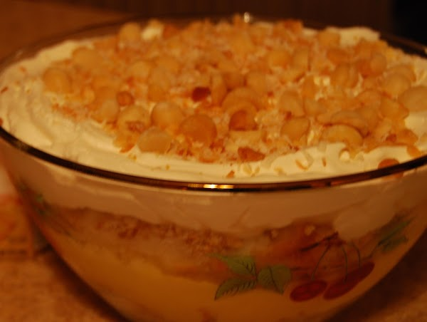 Using a trifle bowl or a large glass bowl, layer ingredients:  half of...