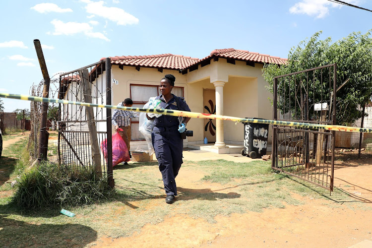 The boyfriend of one of the dead in the Vlakfontein mass killing is being questioned by the police.