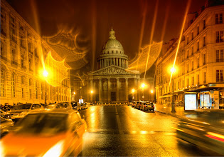 Photo: The Pantheon in Paris in evening Firelight Shared first to Google+ as thanks for all of you and gift to new ciclees!  It was close to midnight and the streets were wet... they were kind of that Euro-wet, where you just want to stay out and take photos until 3 A.M. -- know what I mean? I was staying here in the Latin quarter, just a short walk away from the Pantheon.  A bit of water got on the lens and created this unexpected fire-like effect. I think it looks so cool that I just left it in... I also like to do pottery. I have a ceramics wheel and everything... and one of my favorite things after the glaze is waiting to see how the glaze will react with the fire... you never quite know. And so the same thing happens with rain on the lens..
