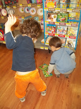 Photo: Pushing the buttons and dancing is the next stop.  Cassius loves it that the CDs are low enough for him to pull off the shelf and stack on the floor.