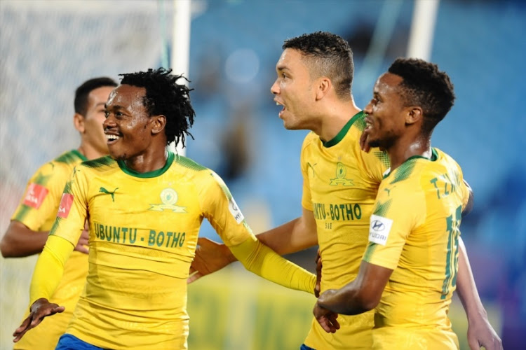 Ricardo Nascimento of Mamelodi Sundowns celebrates his goal Percy Tau and Themba Zwane during the Absa Premiership match between Mamelodi Sundowns and Golden Arrows at Loftus Versfeld Stadium on April 17, 2018 in Pretoria, South Africa.