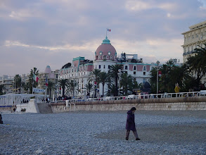 Photo: A view across the smooth-stone beach to the Negresco, a symbol of the Cote d'Azur tradition of luxury.