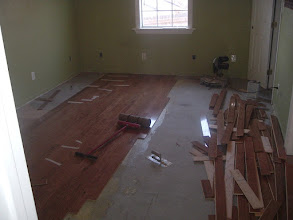 Photo: gluing down new hardwood over old hardwood floors, above ground. after installing first installed 1/4 plywood to close in gaped old floor  wood floor gaps, going opposite direction with new floor.