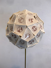 """Photo: """"Sixty Kinematic Chains--detail"""" The sixty kinematic chains are applied as laser toner decals, which retain the iron oxide after firing. The sixty kite shapes (that form a sixty-faced deltoidal hexecontahedron) are cut from a porcelain slip slab and purposely warped. A special clear glaze was formulated (after 64 tries!) that crazed in just the right way, into which India ink was rubbed to accentuate the cracks."""