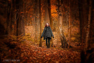 Photo: Echoes Of Silence  Only here when the earth has a heartbeat Do I hear the echos of silence Only here when alone together with you all Do I feel the pulse of life Only here within another world Do I know my own.  My wife in Delemere forest taking in what is around, a wonderful place to be in autumn.