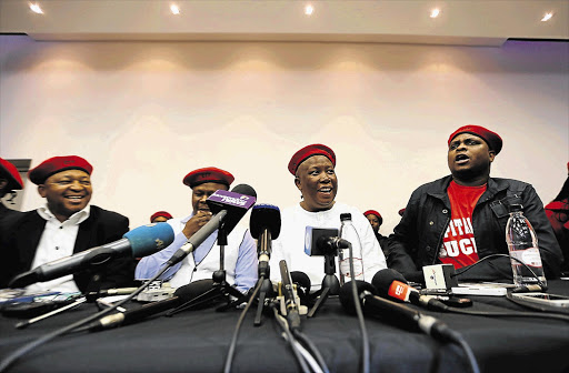 Former ANC Youth League leader Julius Malema flanked by, from left, businessman Kenny Kunene, Mpho Ramakatsa and former ANC Youth League spokesman Floyd Shivambu at the launch of the Economic Freedom Fighters at the Constitutional Hill in Braamfontein, Johannesburg.