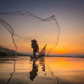 Fisherman by Visoot Uthairam - People Street & Candids ( laos, fish, thailand, thai, travel, people, asian, bangkok, balance, sky, nature, farmer, indonesia, action, working, light, cambodia, job, lake, tourism, environment, food, culture, reflection, tropical, net, burma, tranquil, life, style, poverty, tradition, asia, man, water, peaceful, poor, traditional, boat, fishermen, myanmar, blue, sunset, background, sunrise, fishing, fisherman, reflect, river )
