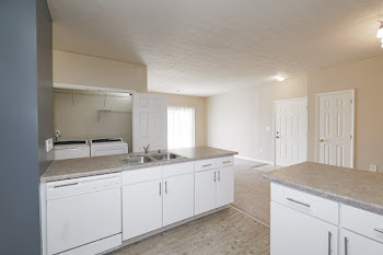 Ashland floorplan fully-equipped kitchen with white cabinets