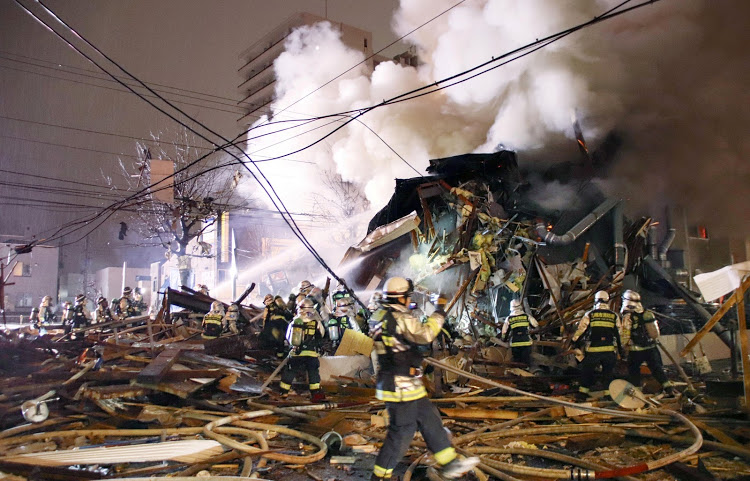 Firefighters operate at the site where a large explosion occurred at a restaurant in Sapporo, Hokkaido, northern Japan.