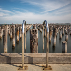 Reminance of Days Gone By by Phil Hanna - Buildings & Architecture Decaying & Abandoned ( old, sky, piers, remains, blue, cloudy, pier, long exposure, ruins, decay )