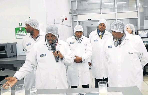 Water and Sanitation Minister Gugile Nkwinti, right, is taken on a tour of the Nestle dairy factory in Mossel Bay. The factory has invested in an initiative to reduce its reliance on municipal water.