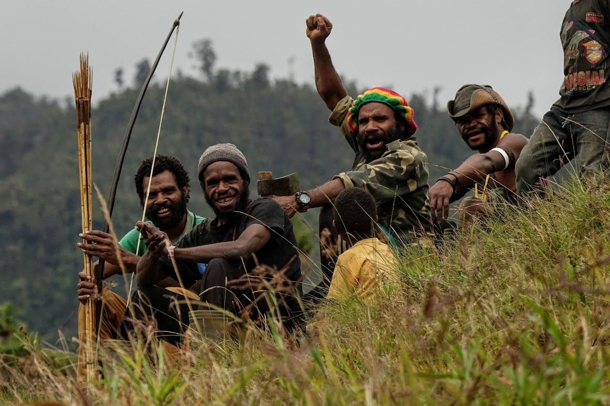 Indonesia. Papua Baliem Valley Trekking. Papua men in Beligama
