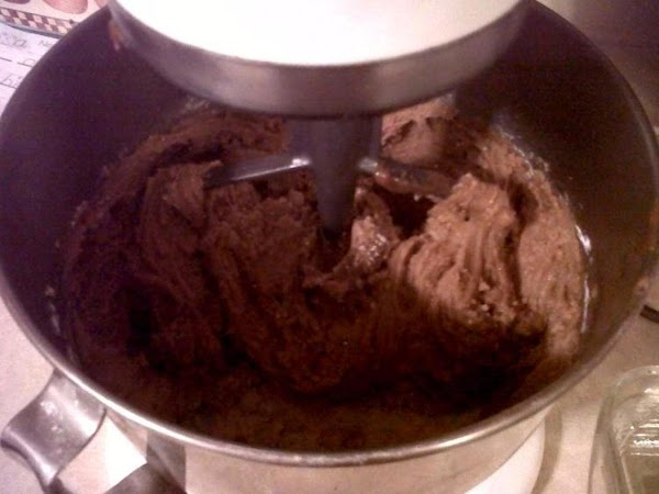 Pour over powdered sugar in a large mixing bowl and beat until smooth.  Pour into 8 x 8 inch pan.