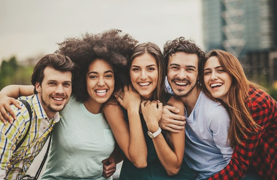 October is Orthodontic Health Awareness Month   Happy Group of Smiling People