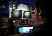 Members of Nasa's Perseverance Mars rover team watch in mission control at Nasa's Jet Propulsion Laboratory in southern California as the first images arrive moments after the spacecraft successfully touched down on Mars.