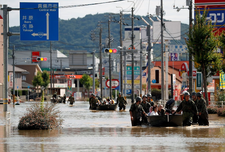 Japan Self-Defence Force soldiers rescue people from a flooded area in Mabi town in Kurashiki, Okayama Prefecture, Japan, July 8 2018. Picture: REUTERS