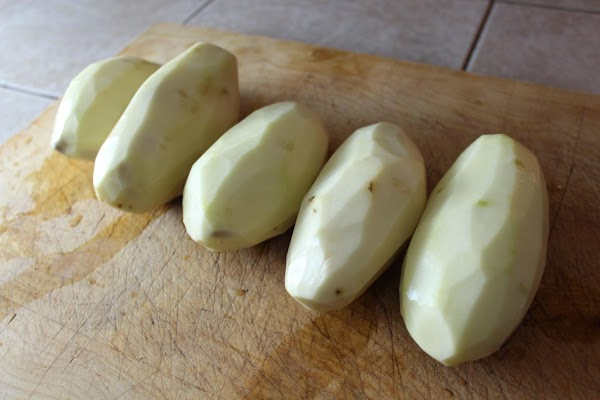 Peel potatoes.