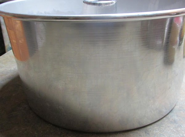 Spray cake pan liberally with Bakers Joy. Be sure to coat  the entire...