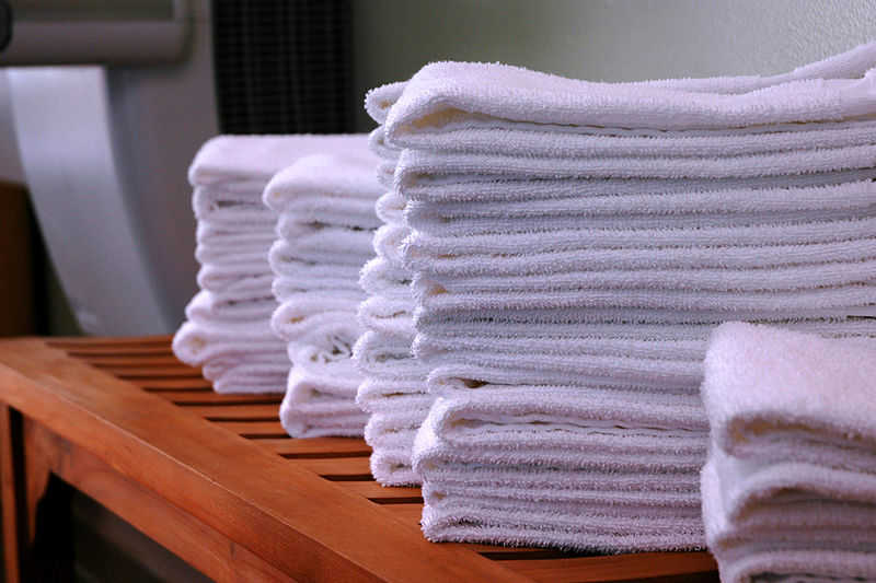 File:Stacks-of-gym-towels-on-wood-bench.jpg