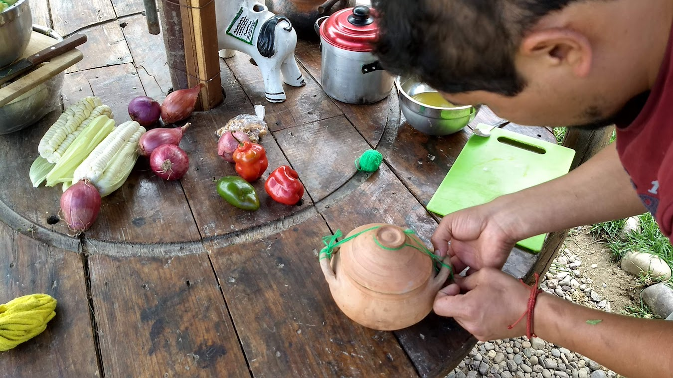 Lucho prepares the food that will go into the pachamanca.