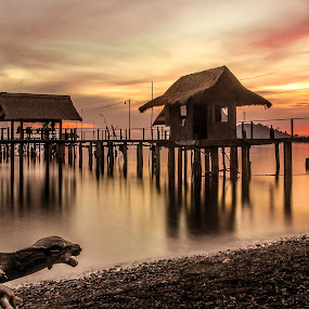 by Jerry ME Tanigue - Landscapes Waterscapes ( water, port, calm, orange, scape, travel, tree trunk, occidental mindoro, slow shutter speed, holiday, tranquil, vacation, sky, color, serene, sunset, fine art photography, peebles, sablayan, resort, long exposure, warft, philippines )