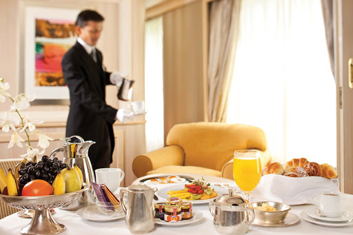 A butler provides breakfast for guests in their suite during a Silversea voyage.