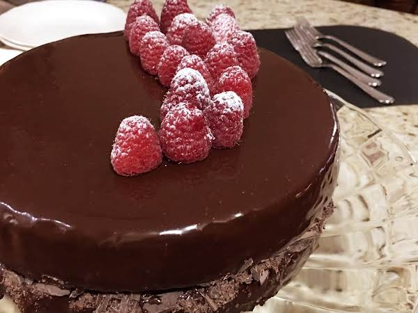 A Chocolate Cake Topped With Raspberries.