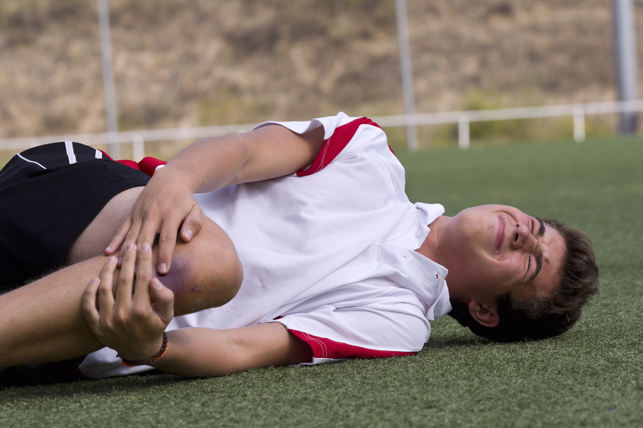 Young athlete with knee injury