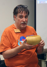 Photo: Beginning the Show & Tell period, Tim Aley shows his newly turned osage orange bowl. It has a masterful profile.