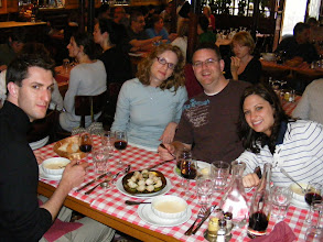 Photo: The gang gets its first taste of escargots, with bread sliced by the giant paper cutter behind us, and the excellent white bean soup. Christopher also chooses the steak tartare for a main course - a must for at least one try on a Paris visit.