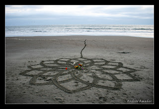 Photo: This design was done by a group of friends celebrating a 70th birthday, guided by me. It was small and simple, and was part of a humble ritual of appreciation. When it was over, the birthday woman drew a line out into the water. A poignant act. Stinson Beach, CA.