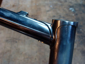 Photo: Stainless top tube, cable guide and head lug.
