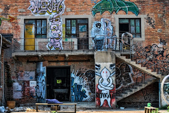 Photo: Stumbled upon this beautiful place while walking through the Art District. The guy in the top right was working on a painting while I explored this building.  798 Art District. Beijing, China