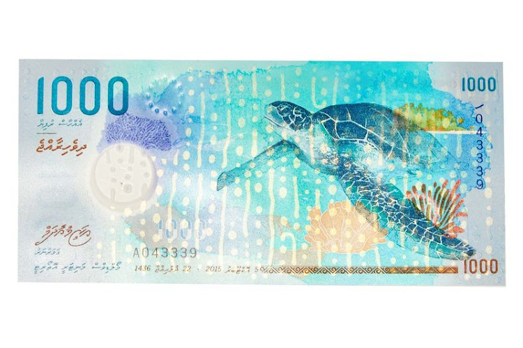 "1,000 rufiyaa  Its theme is ""the beauty in our surrounding."" The primary side depicts a whale shark, with an underprint that gives shading to its skin; on the obverse is a green turtle."