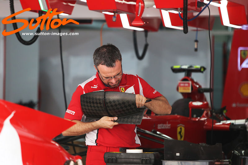 Photo: Ferrari mechanic. Formula One World Championship, Rd17, Indian Grand Prix, Buddh International Circuit, Greater Noida, New Delhi, India, Preparations, Thursday 25 October 2012.
