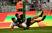 Salesi Rayasi of New Zealand attempts to score at the corner flag while being tackled by Luciano Gonzalez of Argentina on day 2 of the 2019 HSBC Cape Town Sevens at Cape Town Stadium on Saturday night.