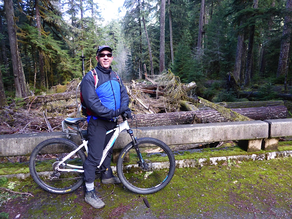 Don posing with his bike in a forest