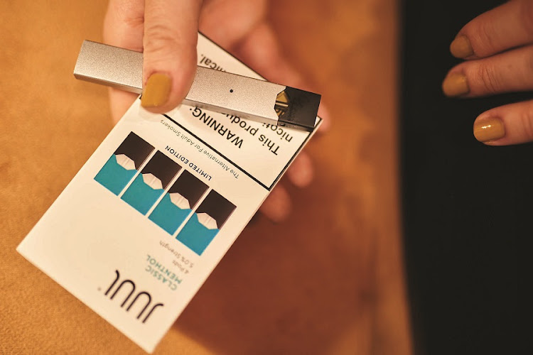 ON FIRE: Juul's refill kit pod volumes grew nearly 600% in 2018 and also. It expects US e-vapor cigarette volume to grow at a compounded annual rate of 15%-20% through to 2023, the company said. Picture: BLOOMBERG/GABBY JONES