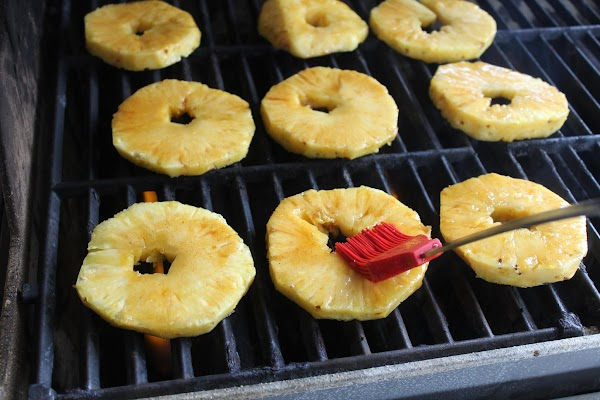 With a basting brush, baste the pineapple slices with the 'Danc'n Orange' glaze while...