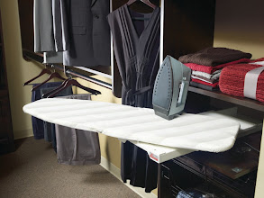 Photo: Closet detail: swing out ironing board