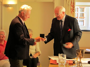 Photo: Dick Pratt retiring RC Dinghies receives Silver Medal