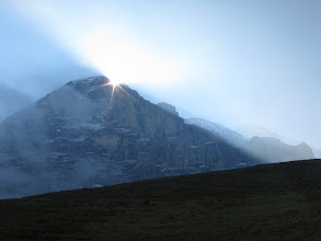 Photo: The next day starts with a dramatic sunrise behind the Eiger.