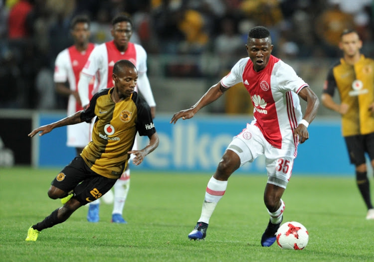 Kaizer Chiefs winger Joseph Molangoane vies for the ball with Rodrik Kabwe of Ajax Cape Town during the Absa Premiership match at Athlone Stadium on February 25, 2017 in Cape Town, South Africa.