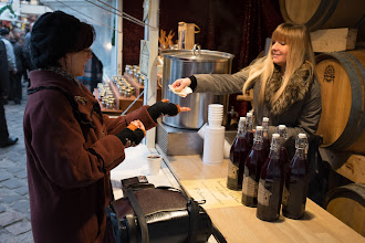 Photo: Kelly purchases some hot spiced wine