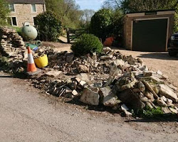 Dry stone wall knocked over by a lorry in Cotswolds