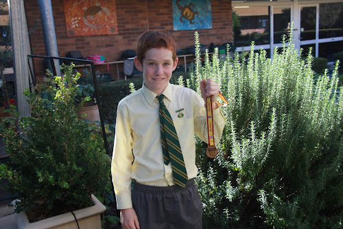 St Francis Xavier year 6 student Sid Harvey with his Polding bronze medal which he won at Eastern Creek.