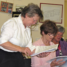 Photo: Musical Director Yvonne O'Conor with choir members Louise Magee and Ann Coe getting everything note perfect at Tuesday night choir practice in KARE Centre, Blessington in preparation for the Christmas concerts
