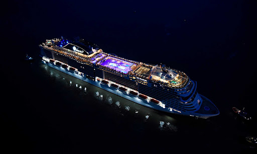 The megaship MSC Grandiosa from MSC Cruises pictured at night.